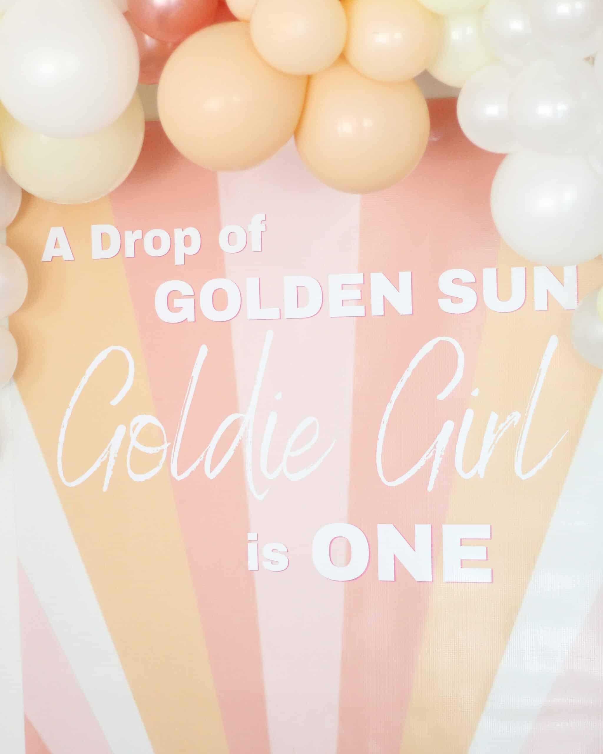 sunshine backdrop with balloon garland