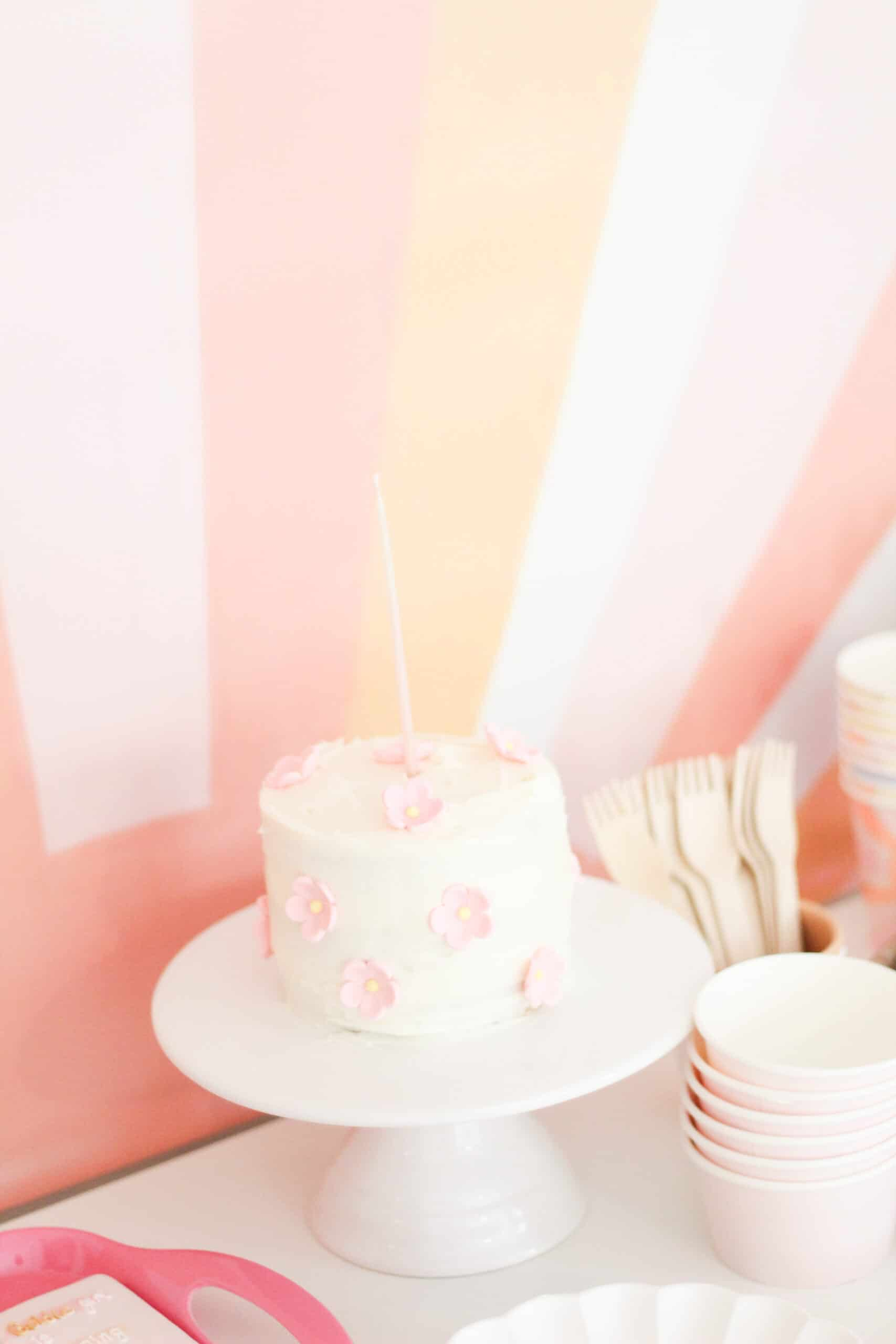 smash cake with pink and yellow flowers