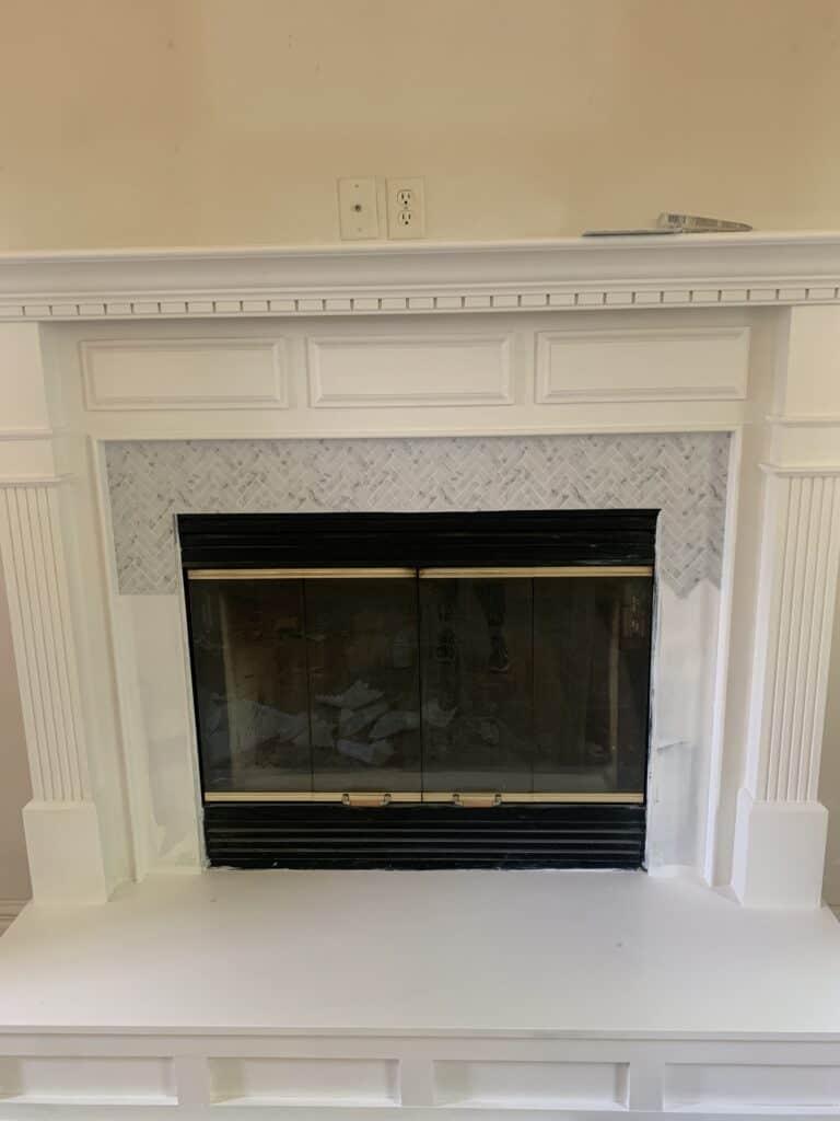 tile backsplash on fireplace