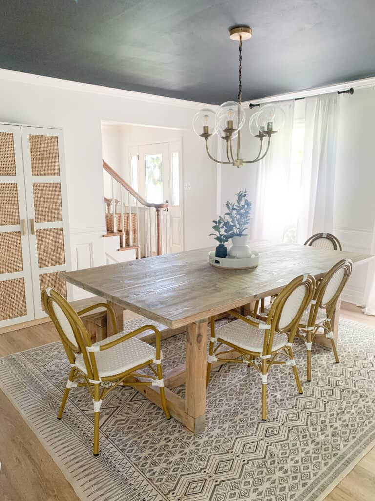 dining room with cane cabinet