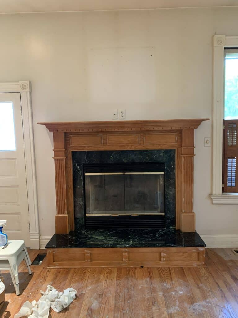 old wood fireplace with green marble