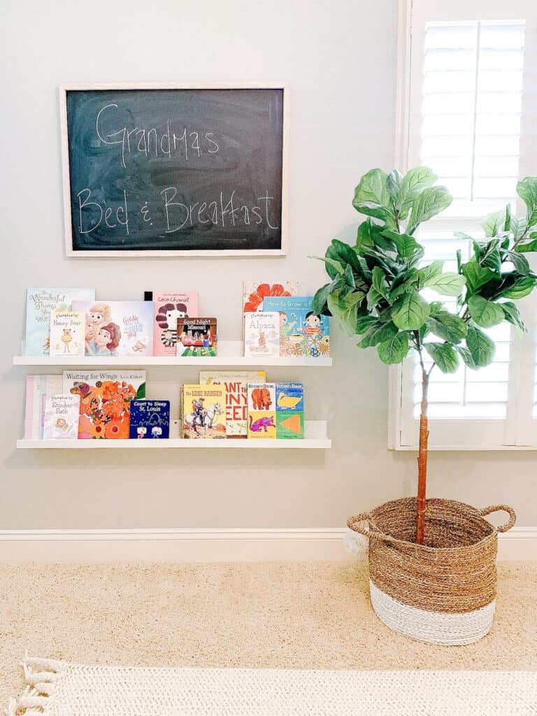 book ledges and chalkboard with fiddle leaf fig tree