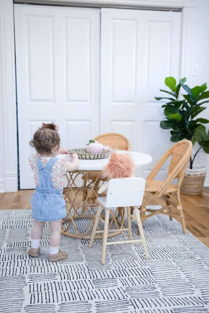 toddler girl by kids table