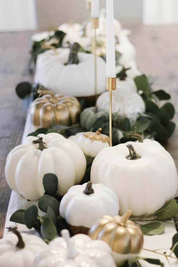 white pumpkins and gold candles for fall tablescape