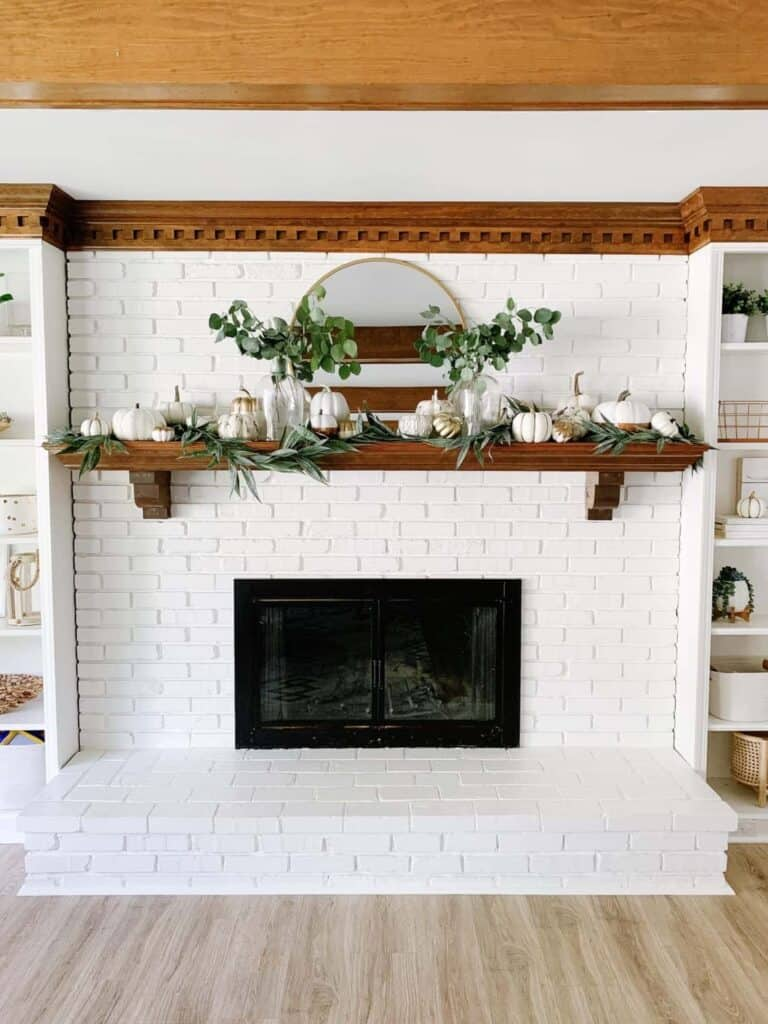 white brick mantle with pumpkins for fall
