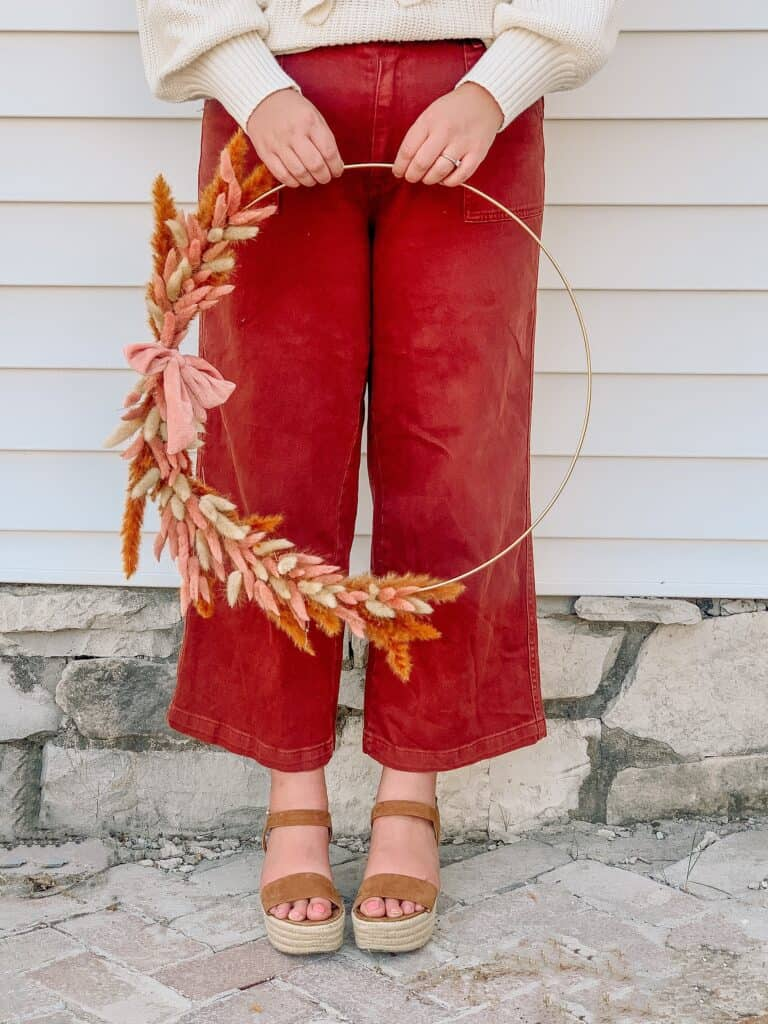 woman holding simple bunny tail Diy fall wreath