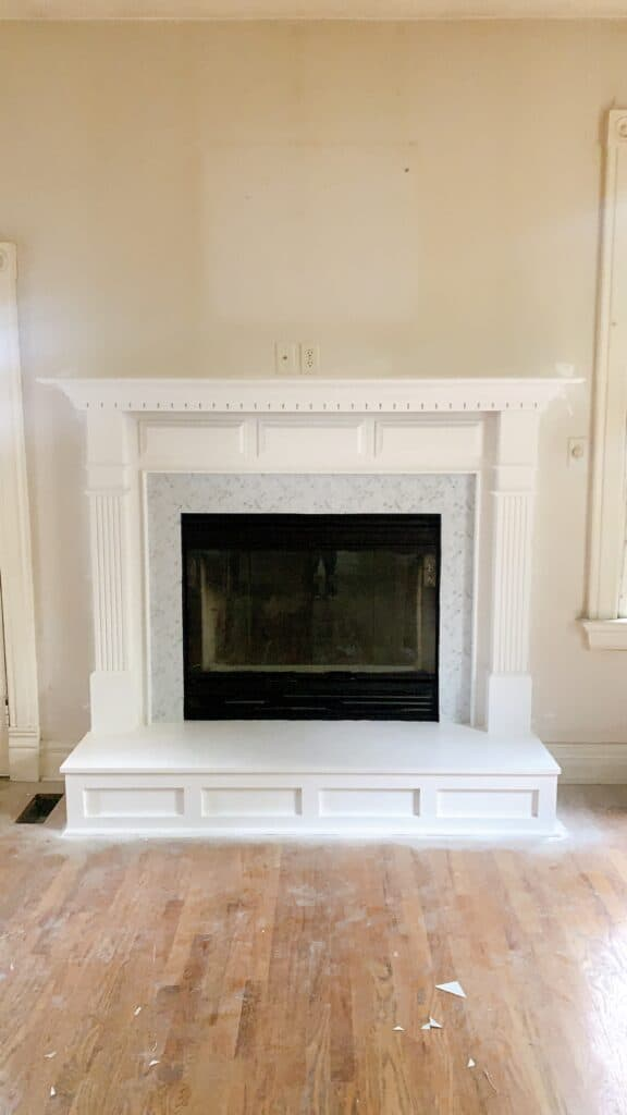 fireplace updated with peel and stick backsplash