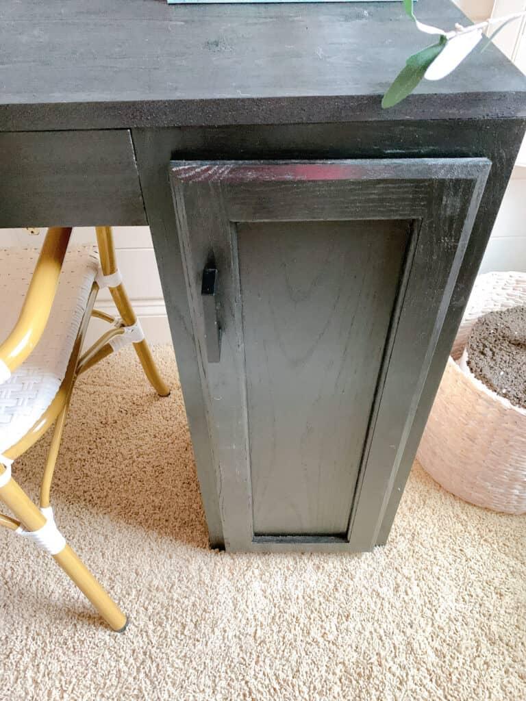 cabinet door on desk