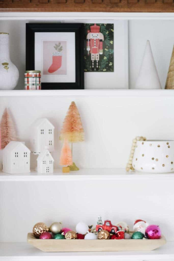 bright Christmas decor on shelving
