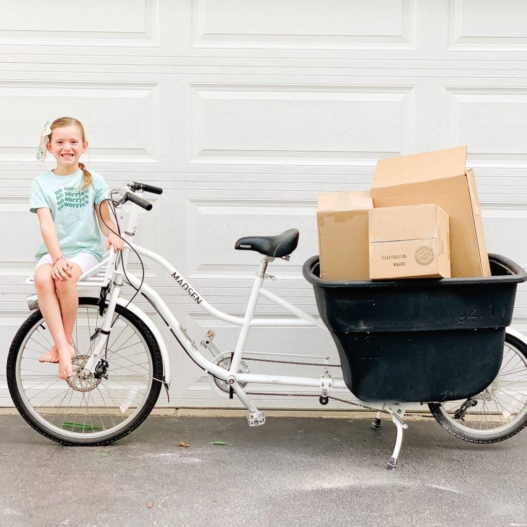 little girl on Madsen cycle