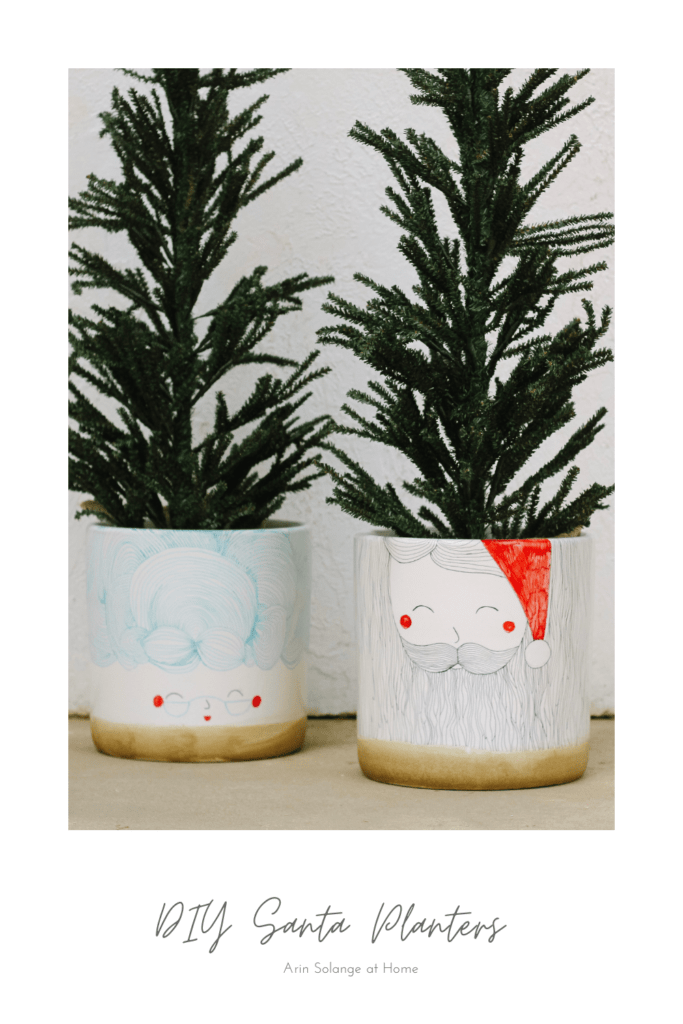 black and red Santa planters with sharpie