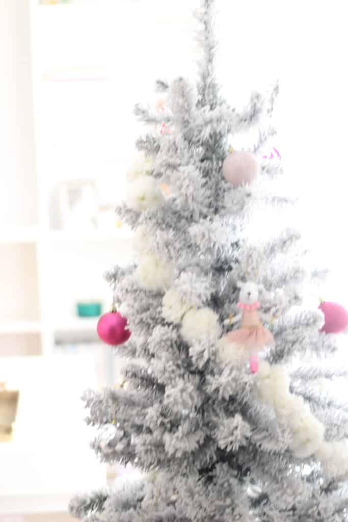 top of a flocked Christmas tree
