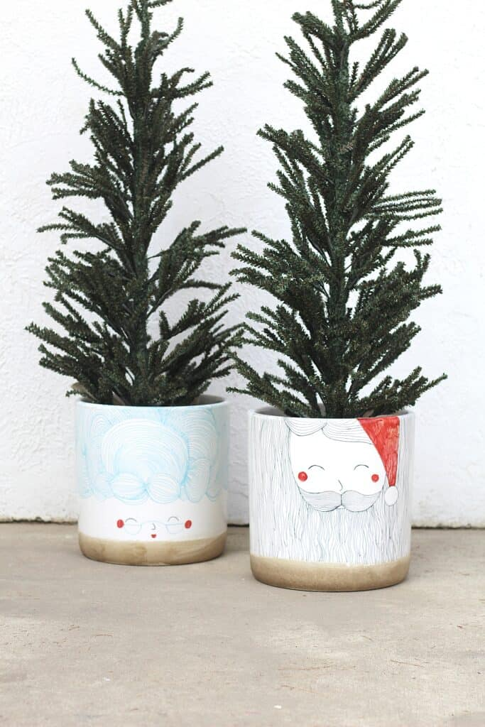 faux christmas trees in planters