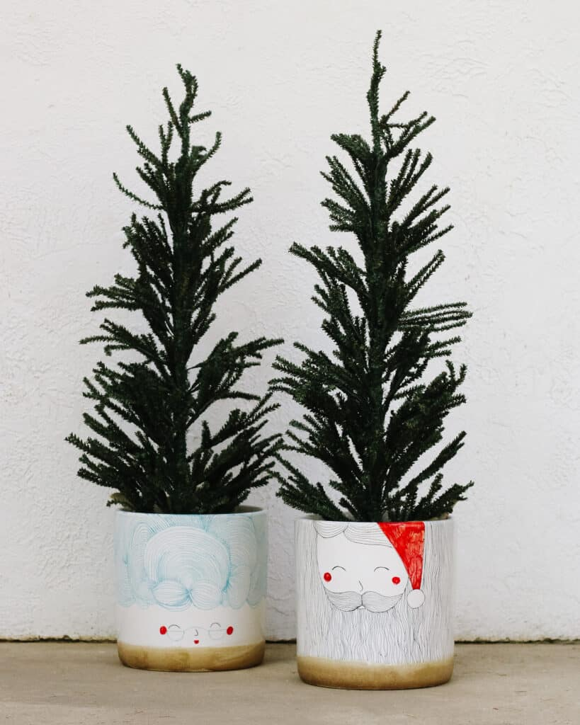 santa and mrs clause pots with faux Christmas trees