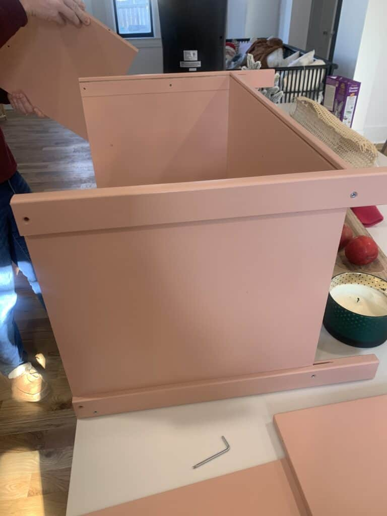 assembling the IKEA Play Kitchen