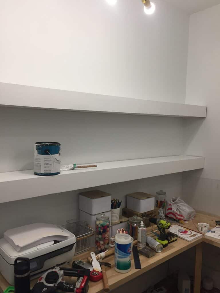two long white floating shelves