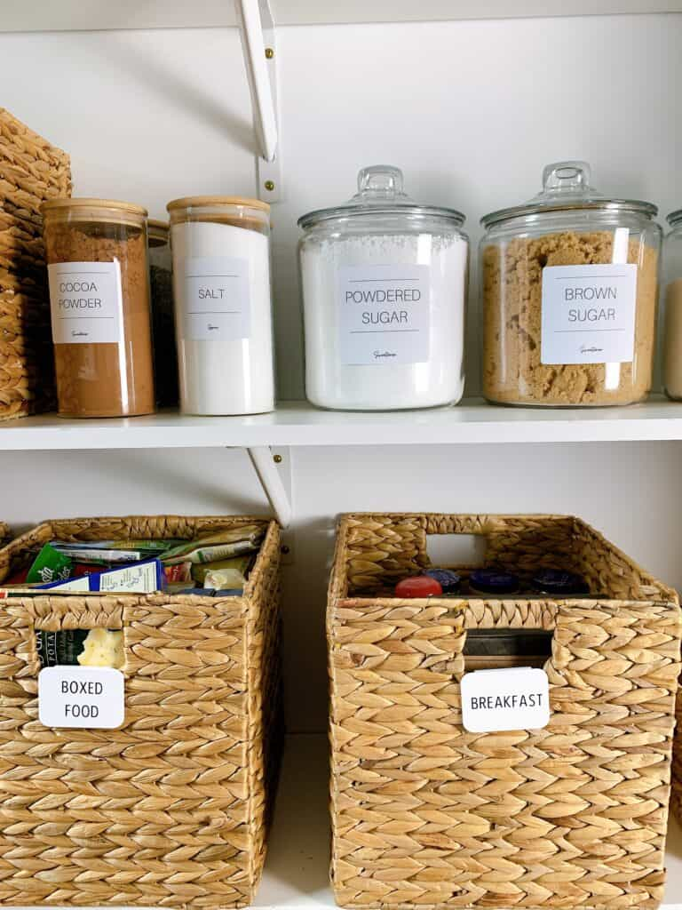organized pantry with baskets and canisters