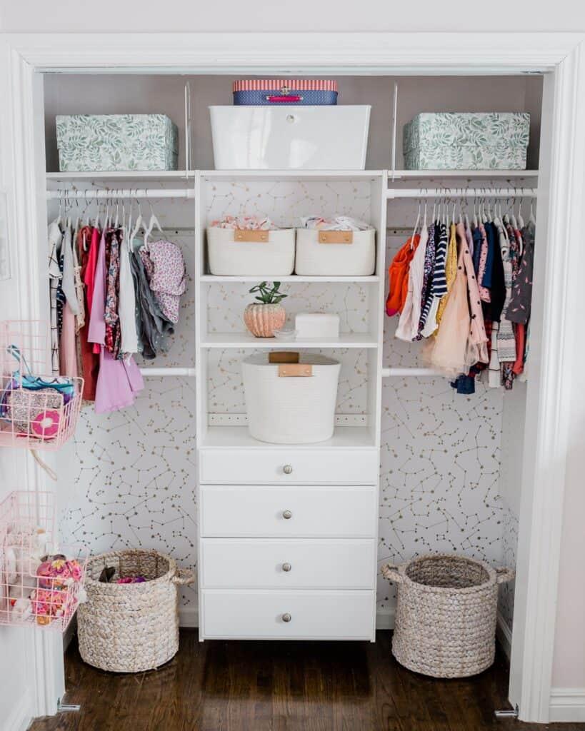 kids closet with wallpaper