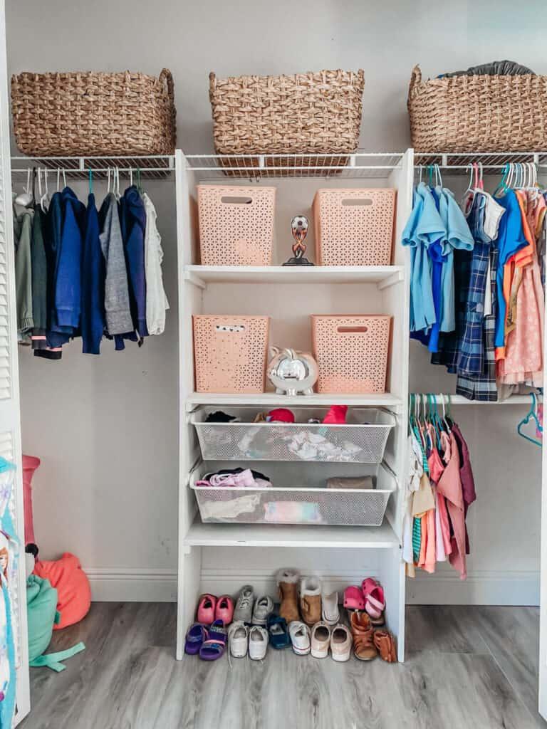 organized kids closet with baskets