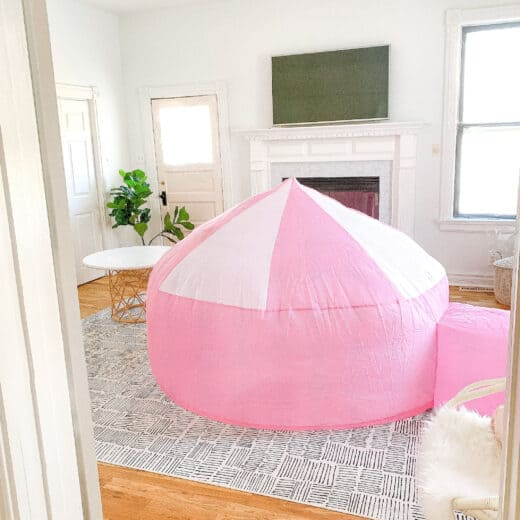 pink air fort in playroom
