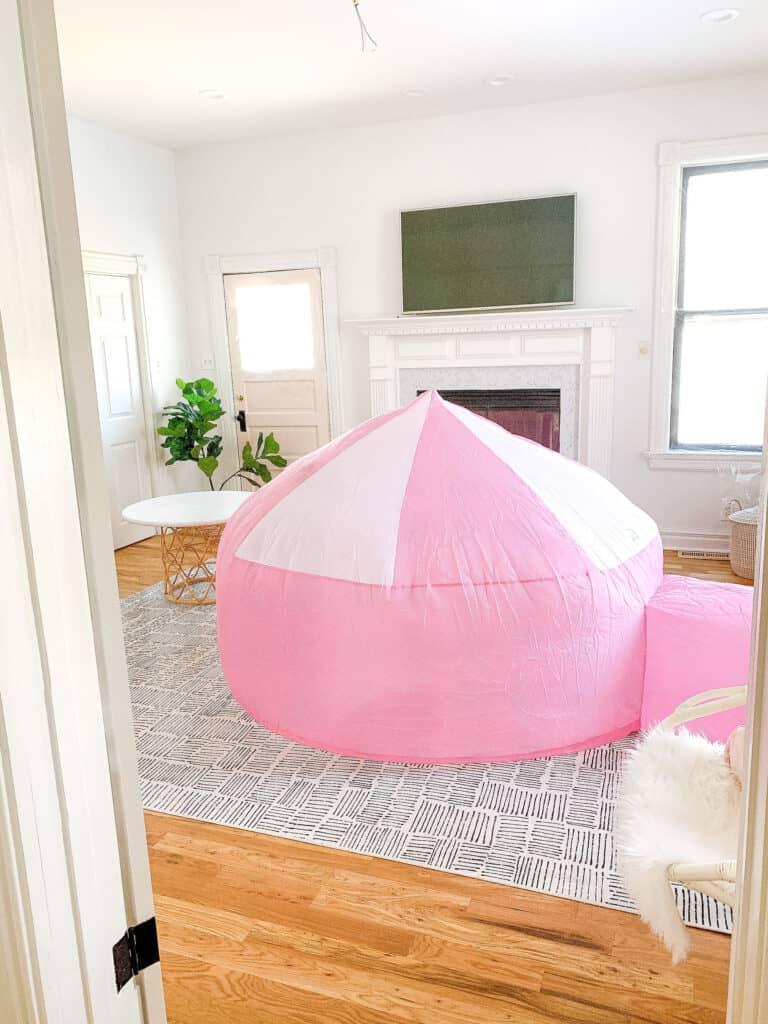 pink air fort in playroom
