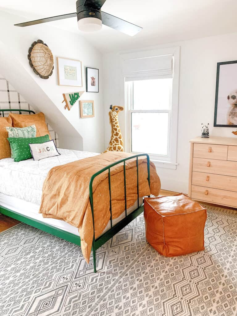 boys room in neutral colors with green