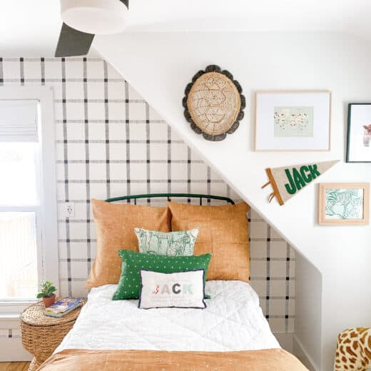 boys green bed against black and white wallpaper wall with green and tan bedding