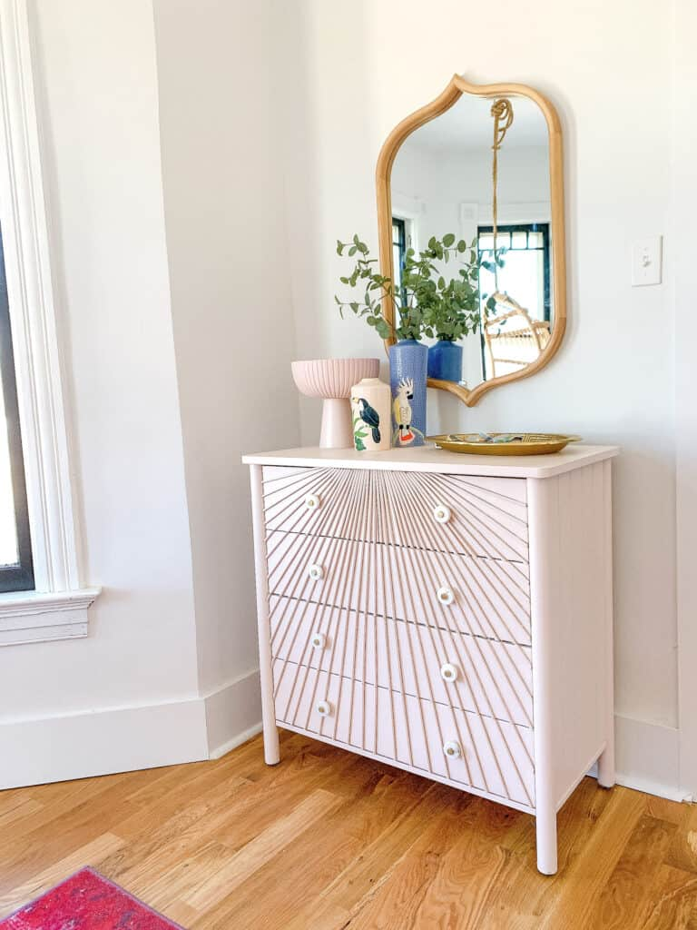 pink dresser with wood dowels
