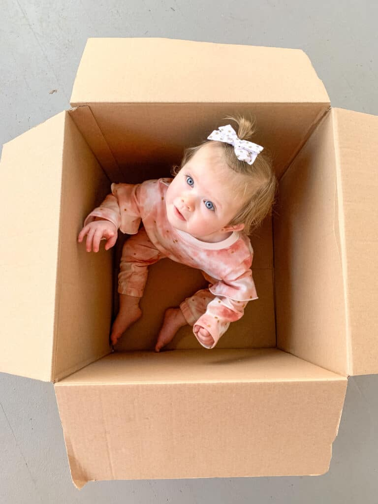 box with baby in it
