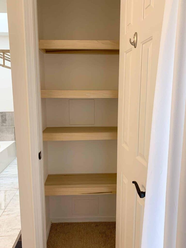 empty linen closet shelves