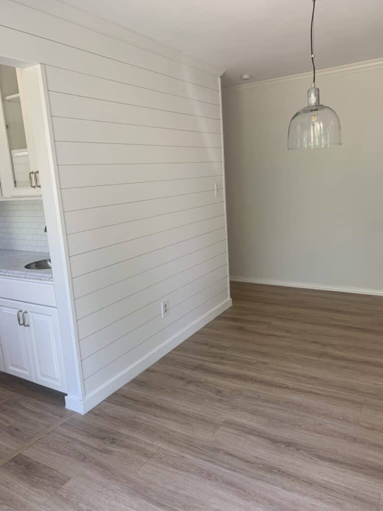 white shiplap wall in kitchen