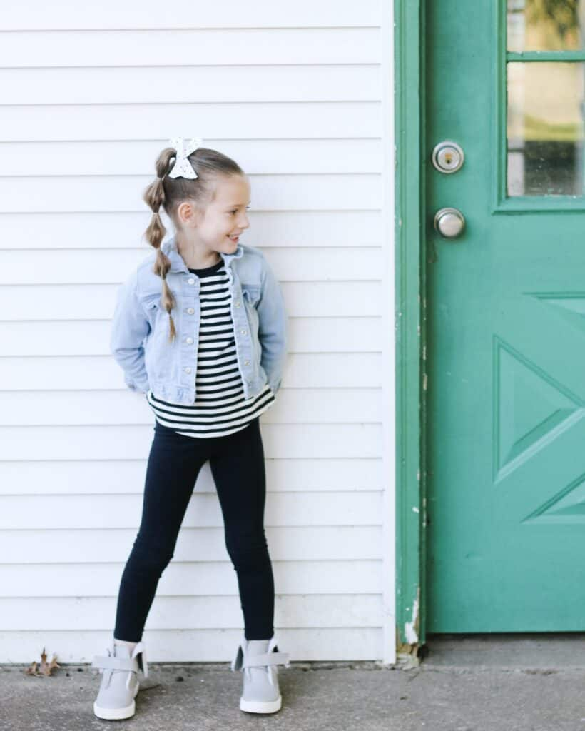 little girl against shed