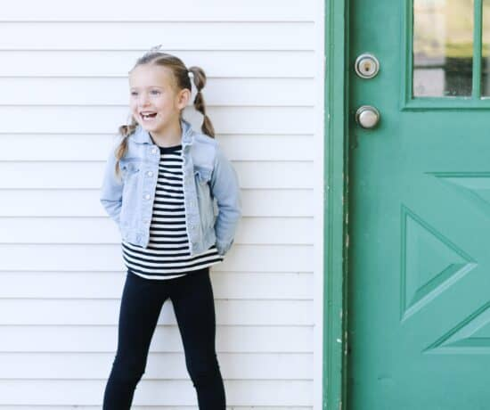 little girl by shed