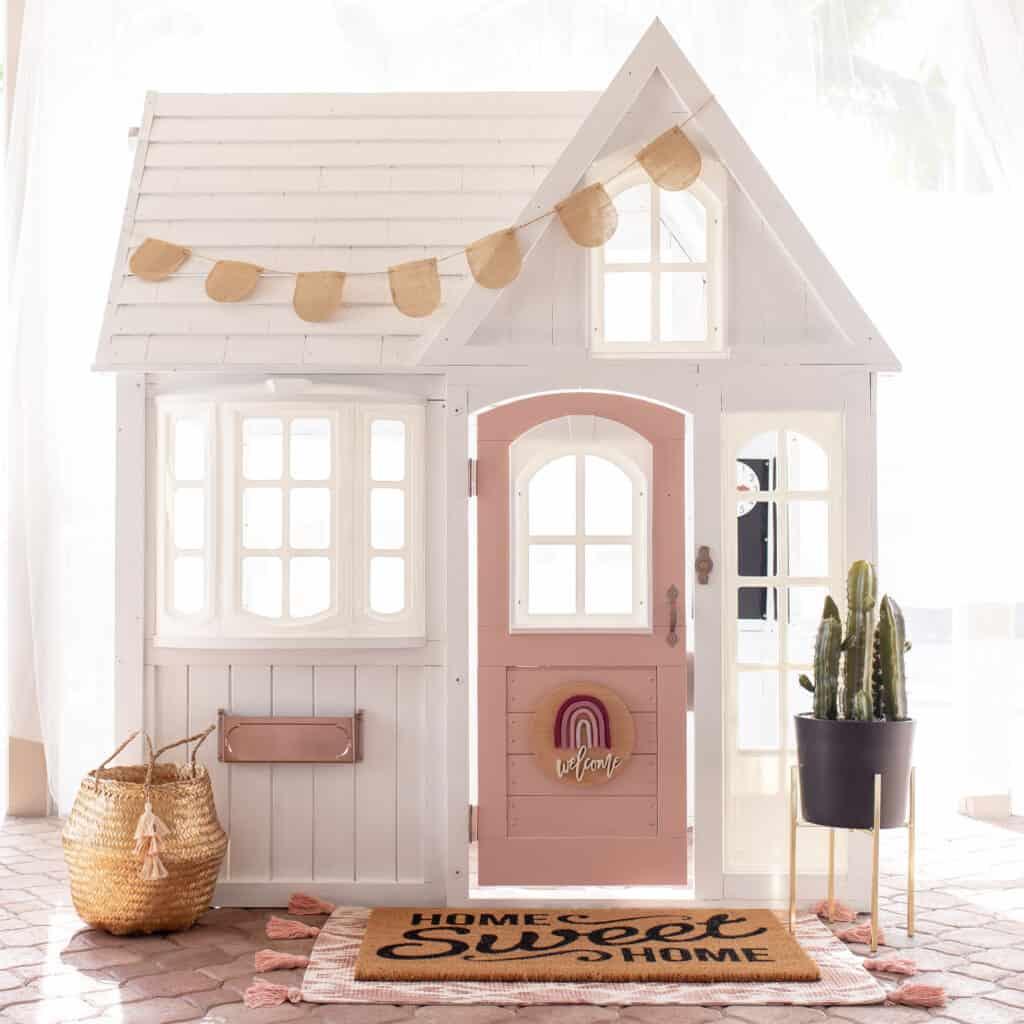 outdoor playhouse with pink door