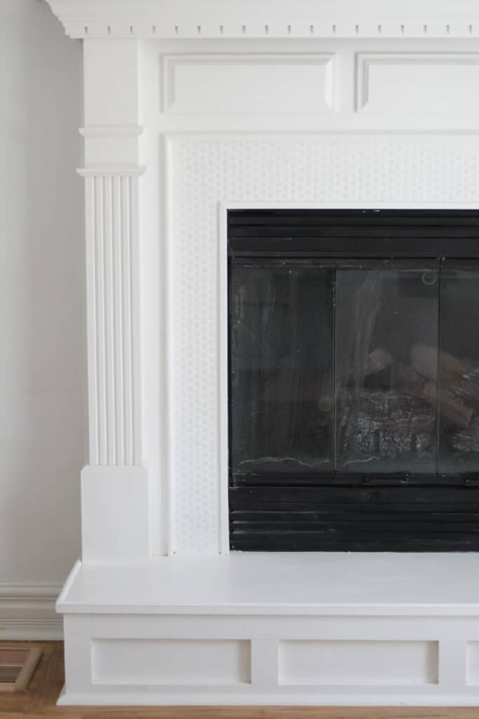 white penny tile fireplace