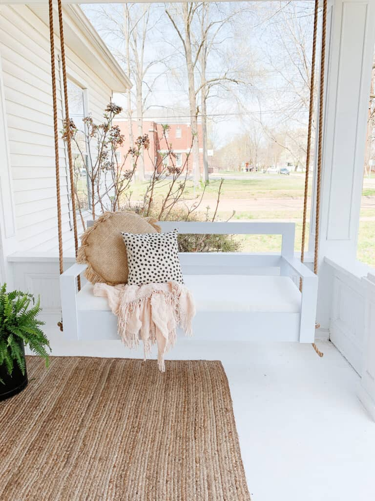 Diy porch swing on white front porch