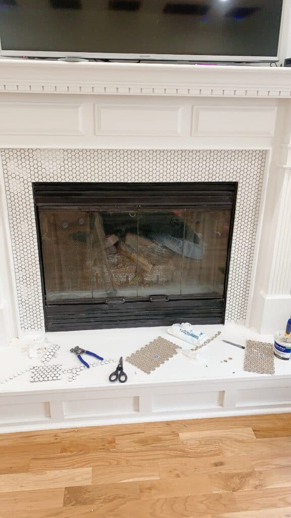 installing penny tile to a fireplace