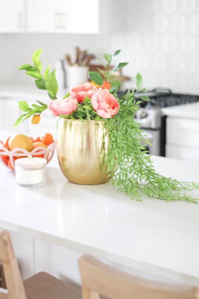 brass vase on counter