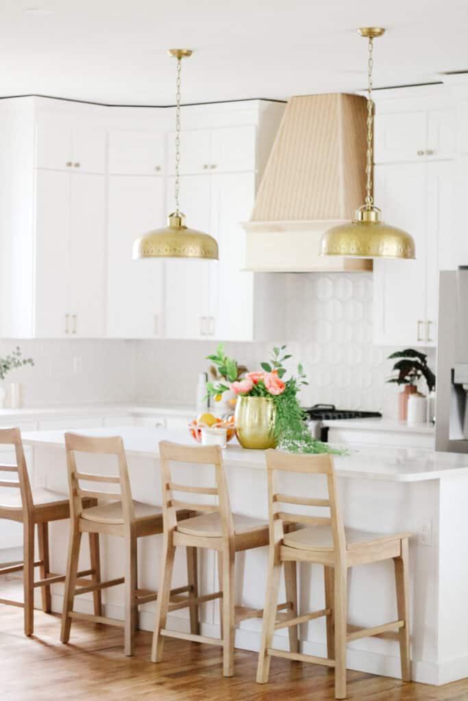white kitchen with brass pendants