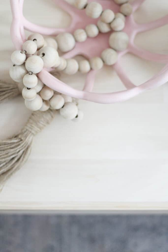 pink decorative bowl with wood beads