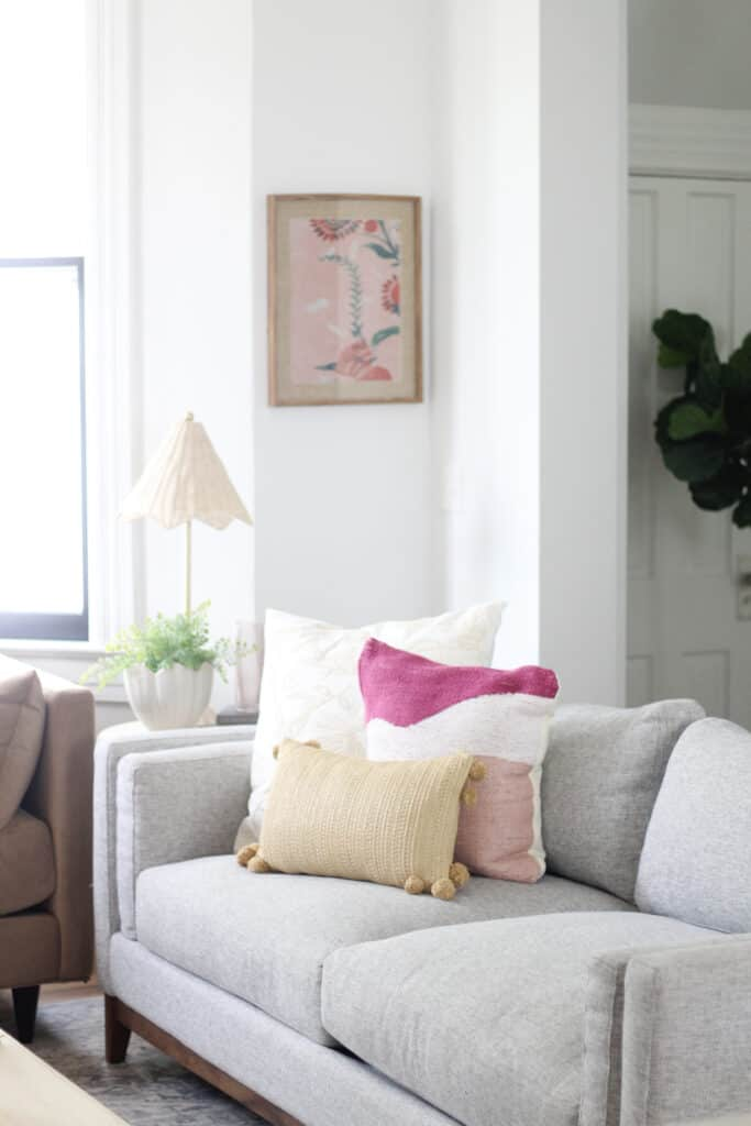 Jonathan Louis grey couch with pink pillows