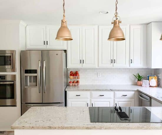 white kitchen with gold lights