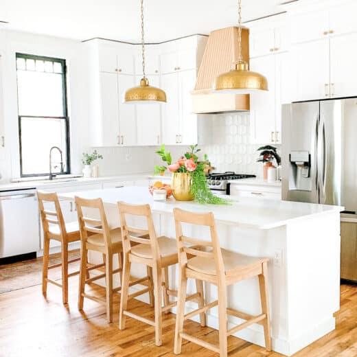 white kitchen with brass pendant light