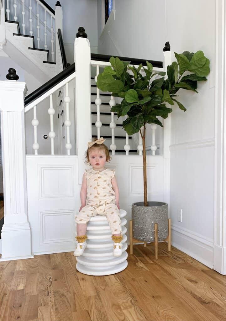 Toddler girl sitting on DIY Stool