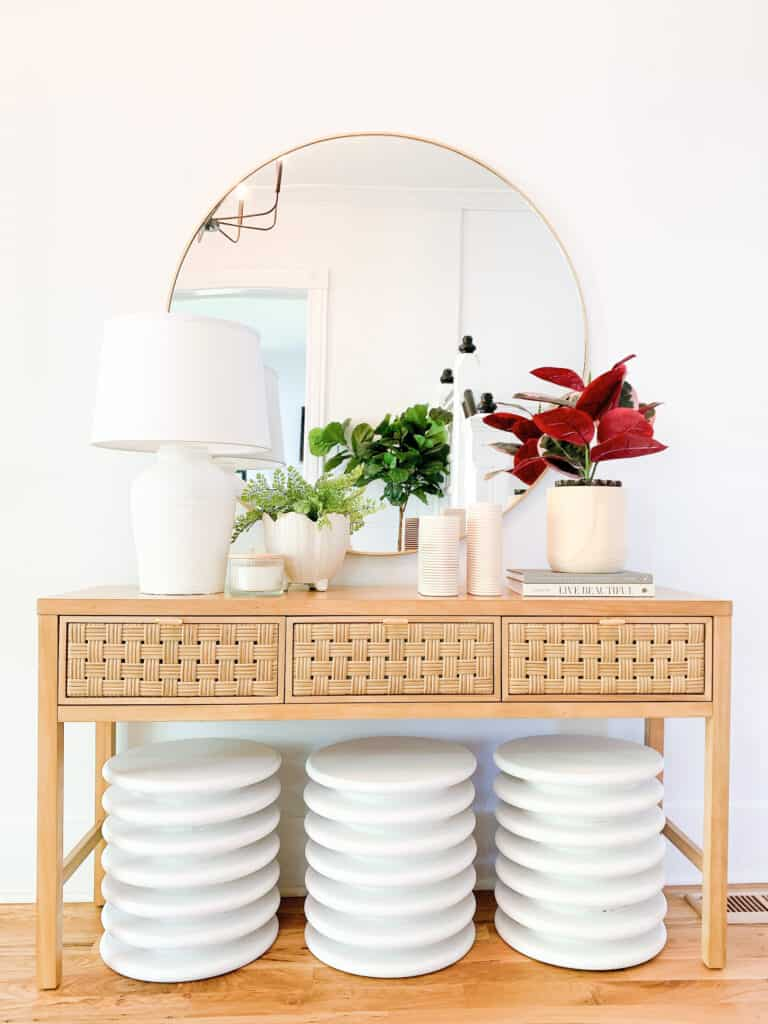 entryway stools under a table
