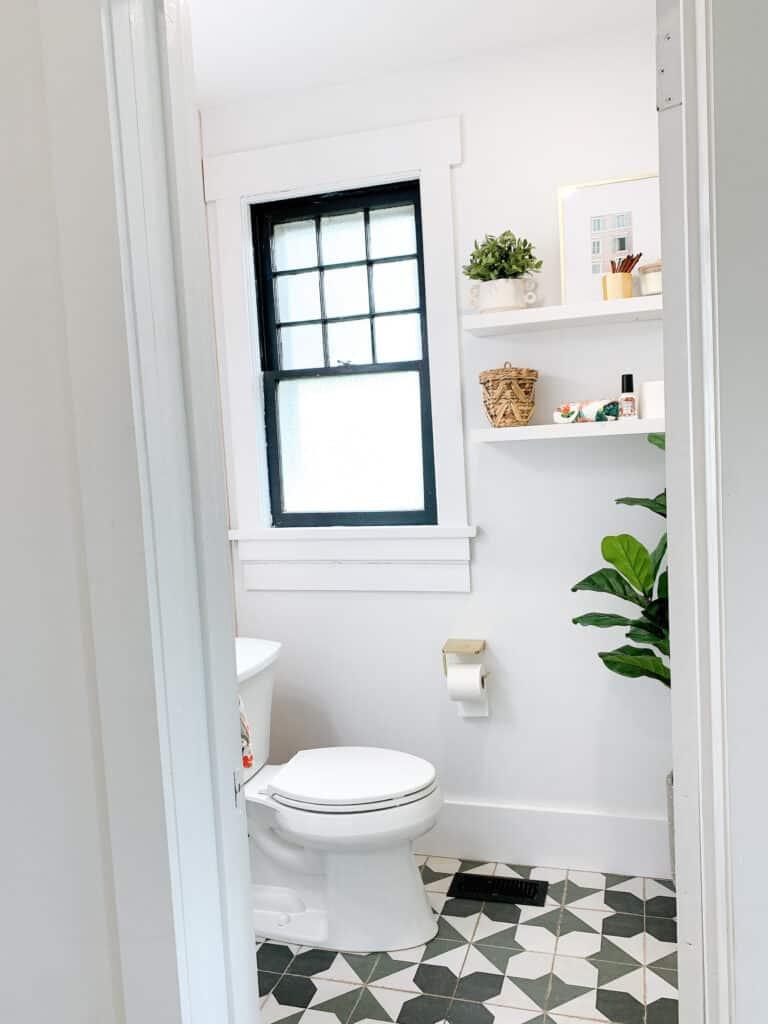 floating shelves and fiddle leaf fig in bathroom