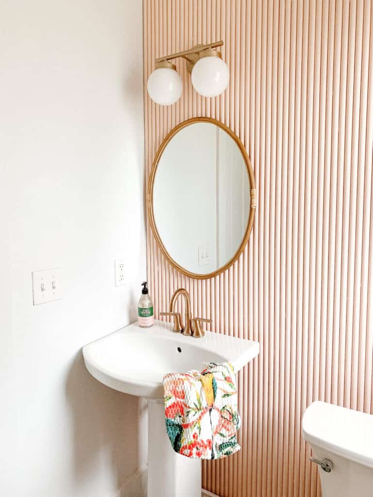 pink fluted wall with PVC pipe