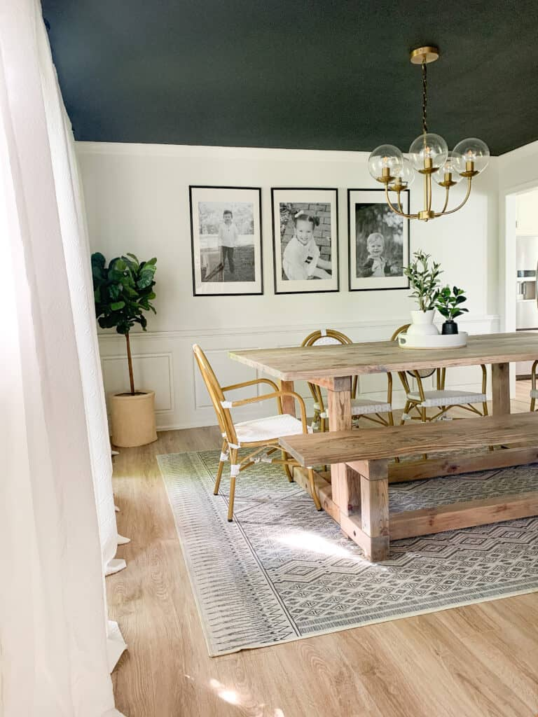 photo of dining room with dark ceiling