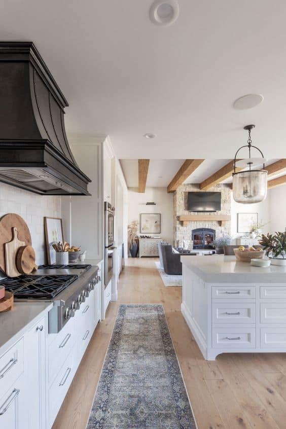 white kitchen with black hood
