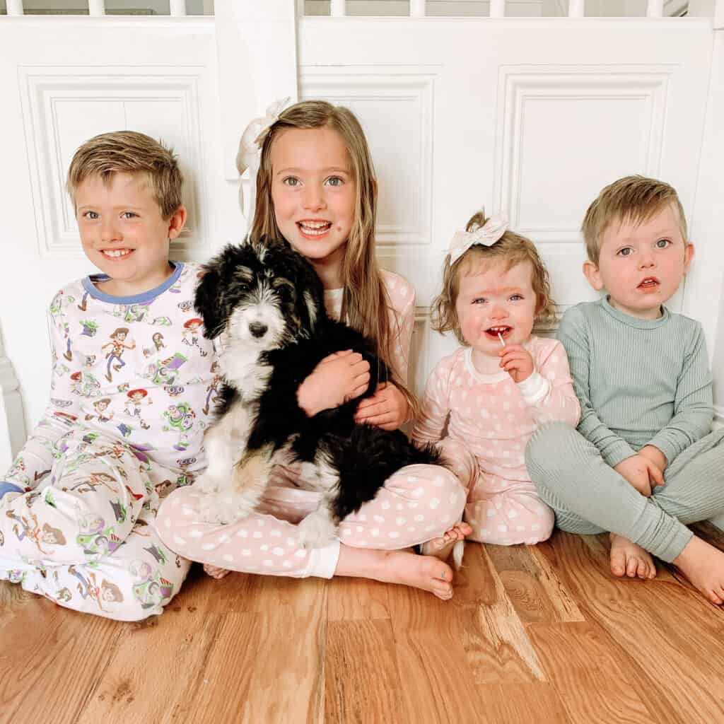 4 kids with their dog